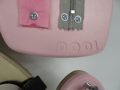 logo dodi pies rozowy tablica sensoryczna